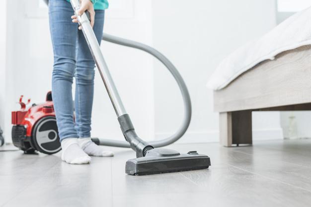 woman-using-vacuum-for-hardwood-floors